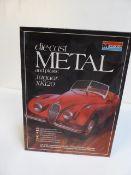 Die-cast metal and plastic Jaguar XK120