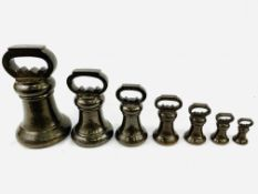 Set of seven Avoir bronze bell proof weights