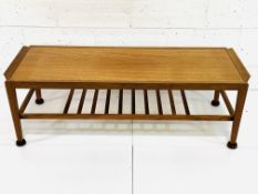 Teak coffee table with newspaper rack under