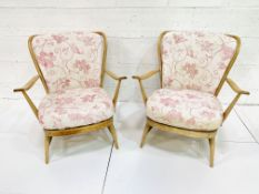 Pair of Ercol rail back armchairs
