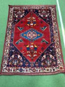 Red ground hand-knotted rug