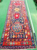 Red and blue ground hand knotted Persian runner