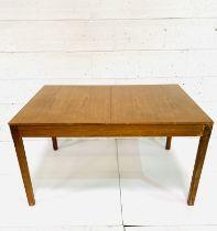 Teak extendable dining table