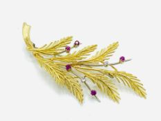 18ct gold brooch set with diamonds and rubies in the form of a sprig of leaves