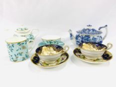 Two Royal Doulton blue and gilt decorated cups and saucers signed E Percy
