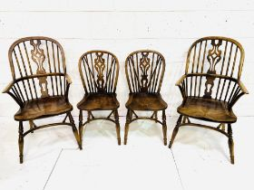 A group of four oak and elm chairs by Brights of Nettlebed.