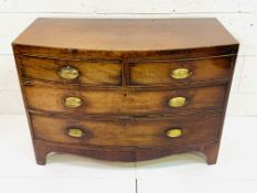 Early 19th Century bow fronted mahogany veneer chest of drawers