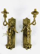 Pair of solid brass electric cherubic wall sconces complete with wooden mounts