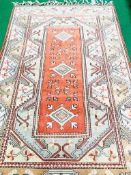 Salmon pink geometric pattern rug