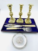 3 Georgian brass candlesticks, silver plated fish servers, and a silver plated Silver Jubilee salver