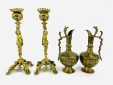 Pair of brass figural candlesticks with two Indian brass ewers