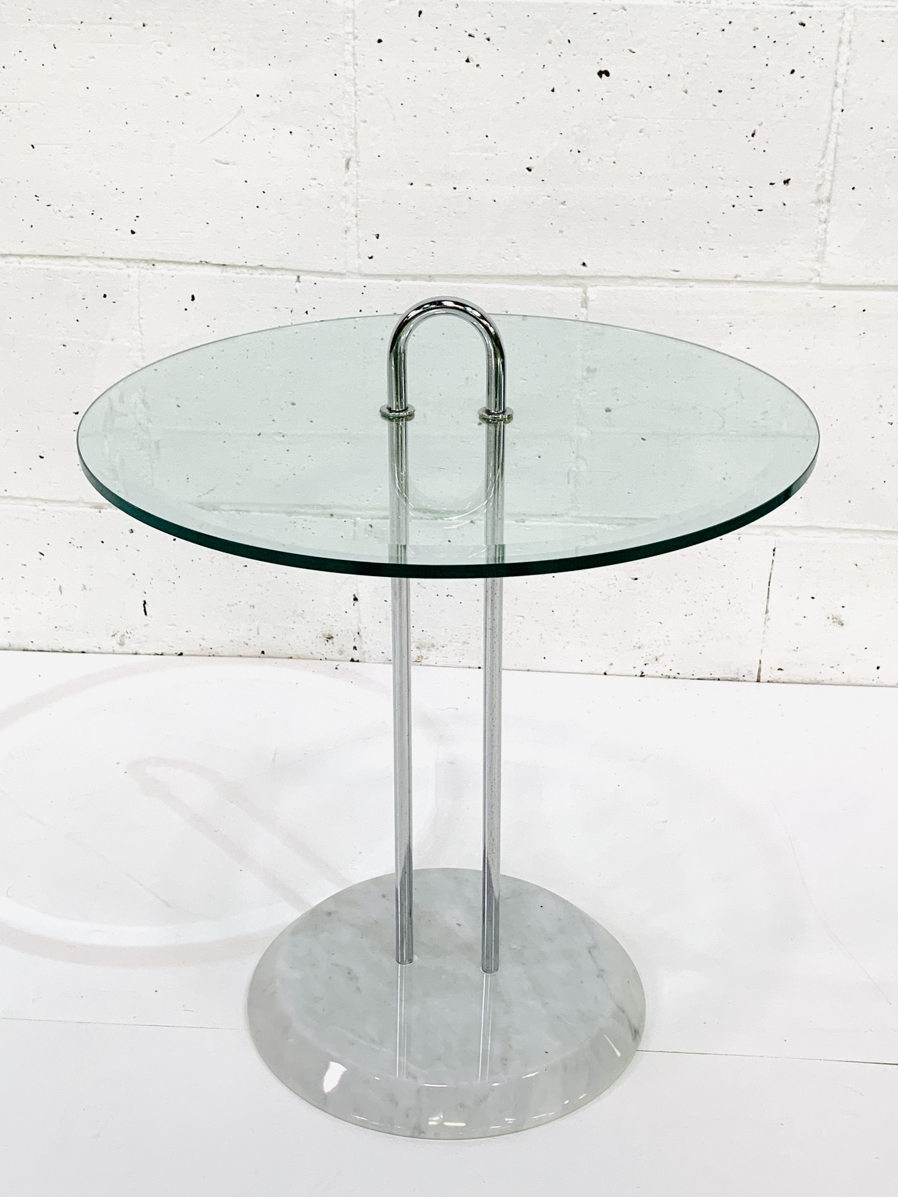 Circular bevelled edge glass top side table