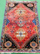 Red ground Quashgai Persian rug