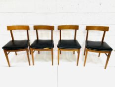Four teak framed curved back dining chairs