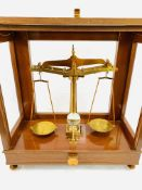A set of brass balance scales to test 1lb by De Grave, Short and Co Ltd, London,