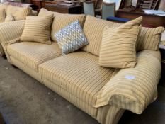 Three seat sofa upholstered in gold coloured striped fabric