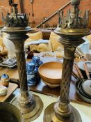 Two tall brass columned lamps