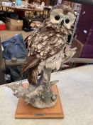A number of figurines of owls