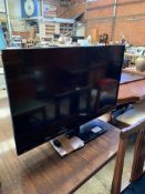 Panasonic TXL 32 LCD TV together with remote.