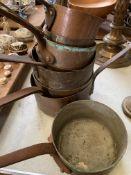 Eight antique copper pans