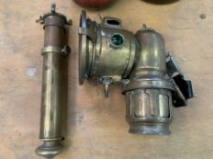 "Lucas ""Calcia Major"" carbide lamp and a brass candle torch"