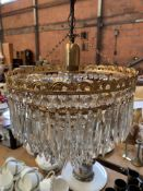 Two brass and glass drop chandeliers