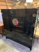 Oriental style black lacquered cabinet.