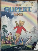 Seven Rupert annuals 1940's-1950's; together with Alice's Adventures in Wonderland