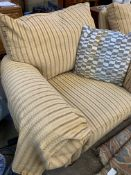 Two armchairs upholstered in gold coloured striped fabric