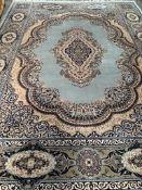 Kishan green ground wool rug