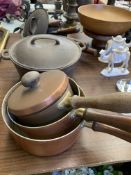 Various copper saucepans and other pans
