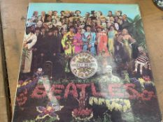 Sgt Pepper's Lonely Hearts Club Band, Simon and Garfunkel's Greatest Hits, and a JVC camera