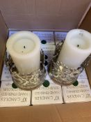 """Two white metal candle holders and 21 boxes of 12 x 10"""" green candles"""