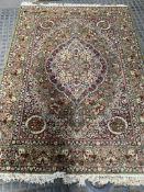 Three green ground rugs