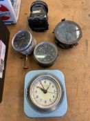 Two vintage car clocks and 2 aviator compasses