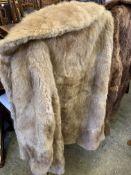 Two fur coats.