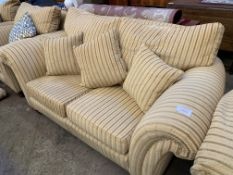Two seat sofa upholstered in gold coloured striped fabric
