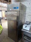 Caravelle stainless steel finish single door upright freezer.