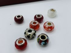 An antique necklace of blown glass beads and other items