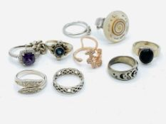 Six various silver rings and four others