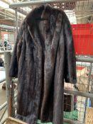 Full length dark brown mink fur coat