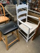 A group of three chairs and a stool