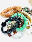 Twelve assorted gemstone bracelets