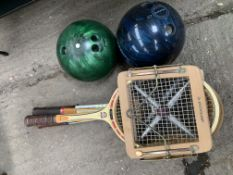 Four assorted wooden frame tennis rackets, and 2 bowling balls