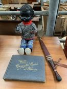 Black doll by Pedigree; together with an album of Wills's Cigarette cards
