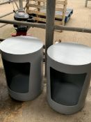 Two cylindrical side tables with integral storage