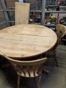 Circular pine extendable table with three pine Windsor style chairs