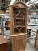 Pine corner cabinet. This item carries VAT.