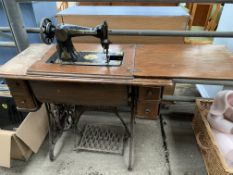 Singer sewing machine on cast iron treadle base