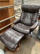 Brown leather effect swivel and tilting armchair with matching footstool